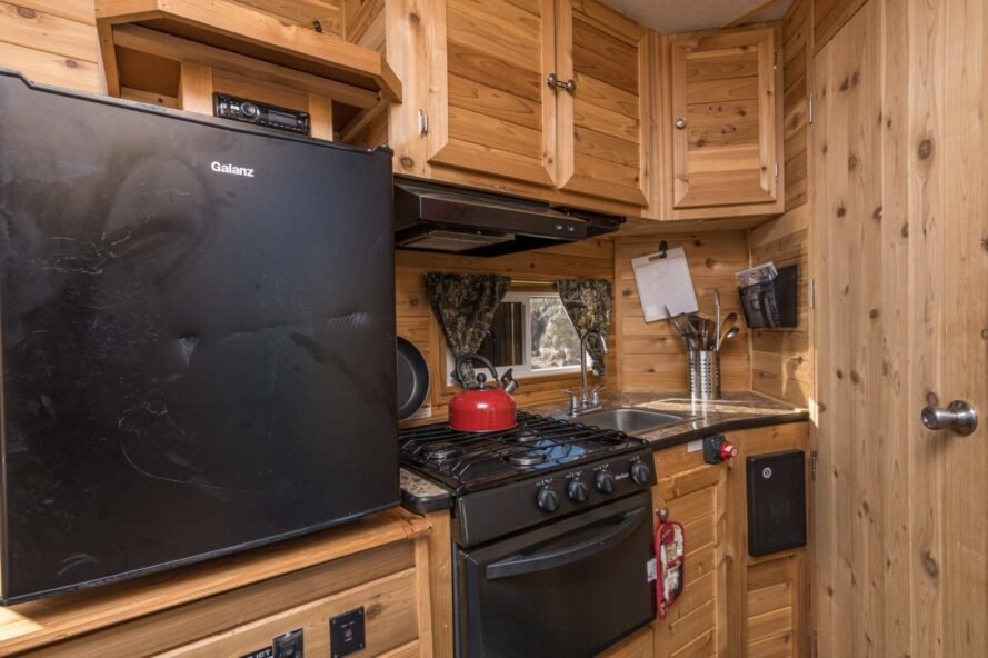 kitchen inside tiny house boat