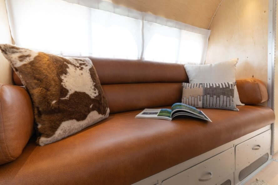leather bench with patterned pillow