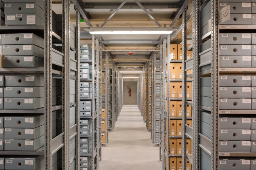 room with several aisles of archives on shelves