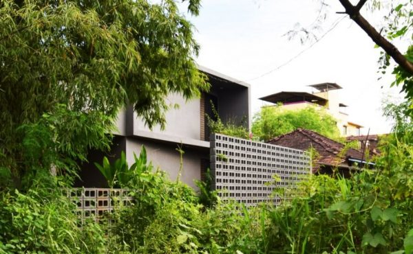 concrete home tucked into greenery