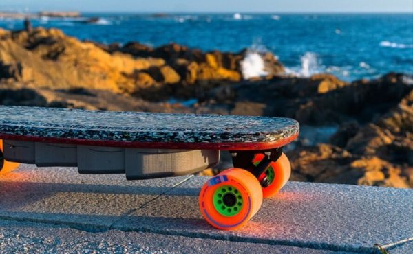 skateboard with bright orange wheels
