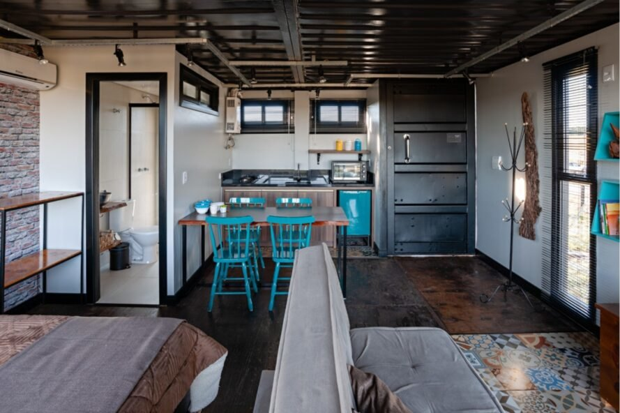 interior living space with kitchen in the background