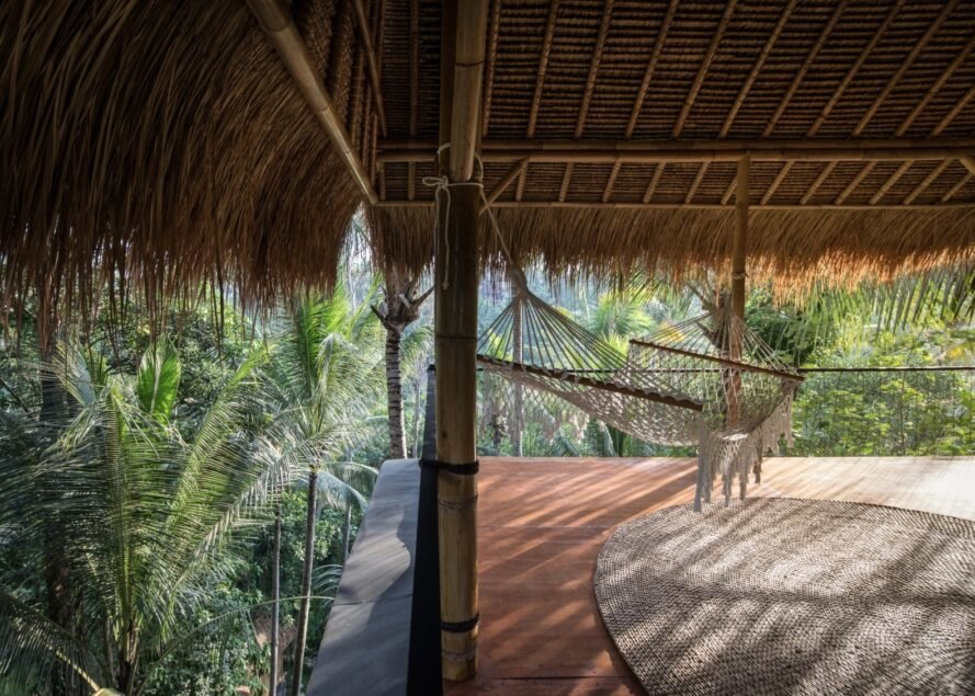 covered deck with thatched roof