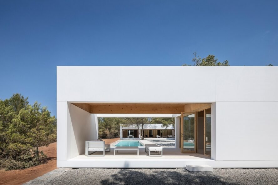 modern, cube-like structure with open walls and covered lounge chair area